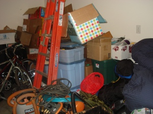 Here is a pile of unpacked items in the garage.